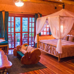 THE PEACE LODGE AT LA PAZ WATERFALL GARDENS DELUXE ROOM KING BED